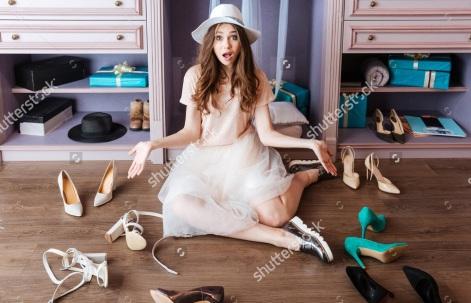 stock-photo-young-pensive-beautiful-girl-choosing-shoes-in-her-wardrobe-435891982